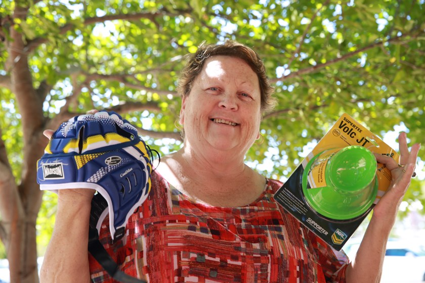 Winners are grinners: Lyn with her JT-signed prize, which she intends to send to her son in Canada.