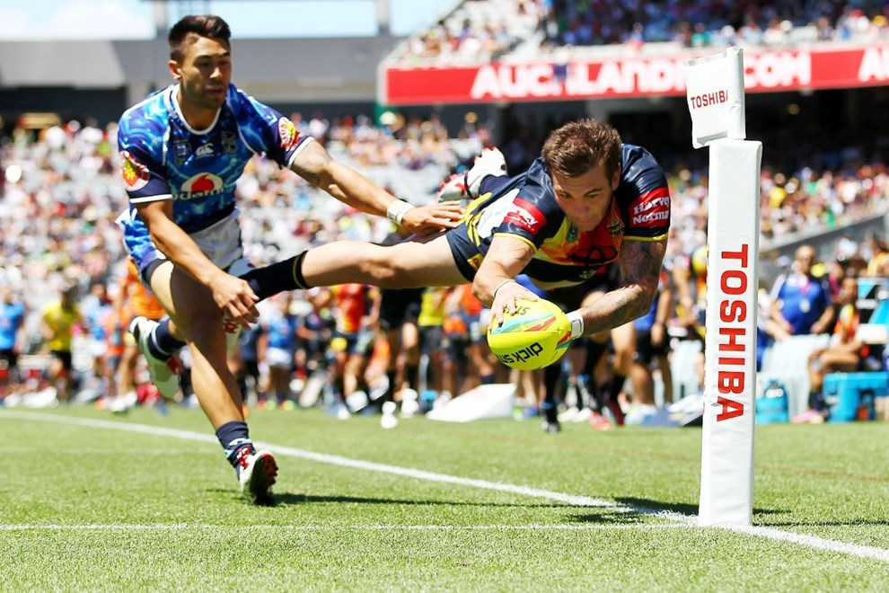 Cowboys' Kyle Feldt dives for a try against Warriors' Shaun Johnson. Day Two of the Dick Smith NRL Auckland Nines, Eden Park, Auckland, New Zealand. Sunday 16th February 2014. Photo: www.photosport.co.nz