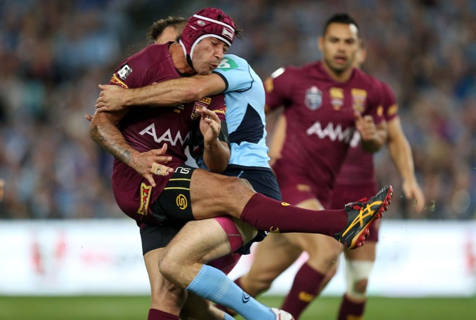 Johnathan Thurston is met by the NSW defence after getting a kick away in Origin II. Credit: Grant Trouville. Copyright: NRL Photos.